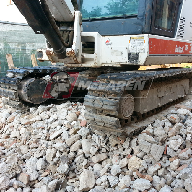 Hybrid Steel Tracks with Bolt-On Rubber Pads for Bobcat E85